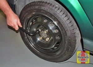 Illustration of step:  Slacken each wheel bolt by half a turn - step 6