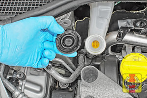 Illustration of step: If the level needs topping up - WEARING GLOVES - carefully open the cap, have a paper towel ready to catch any drips because brake fluid is corrosive - step 3