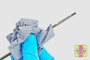 Illustration of step: Withdraw the dipstick and wipe clean with a paper towel - step 2