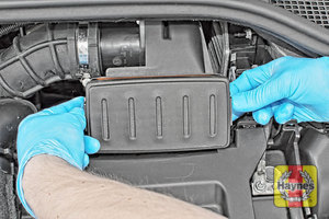 Illustration of step: Undo the two retaining clips and carefully lift the air filter cover - step 2