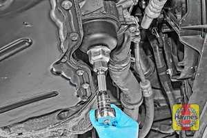 Illustration of step: Loosen the oil filter housing by unscrewing anticlockwise - step 3