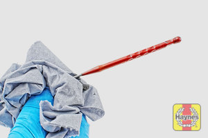 Illustration of step: Wipe clean with a paper towel, reinsert fully and withdraw - step 6
