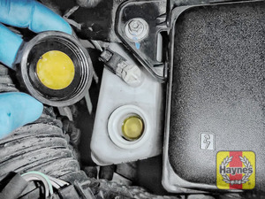 Illustration of step: If the level needs topping up – WEARING GLOVES - carefully open the cap, and have a paper towel ready to catch any drips as brake fluid is corrosive - step 3