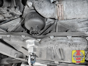Illustration of step: Fit a 24mm filter wrench socket securely onto the oil filter housing - step 3