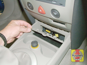 Illustration of step: Unclip the panel from the centre of the facia to access the diagnostic plug - step 2