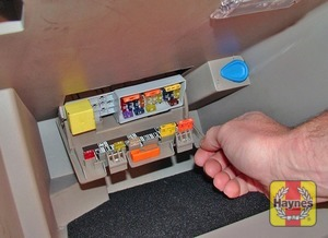 Illustration of step: Open the glovebox and unclip the main fusebox panel - step 1