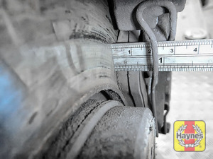 Illustration of step: Using a ruler, measure the approximate thickness of the remaining wear material on the brake pad - step 6