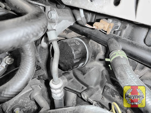 Illustration of step: Using a 3-jaw oil filter wrench, unscrew the filter anticlockwise and remove the old oil filter - step 3