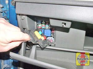 Illustration of step: Open the glovebox, and unclip the cover to access the main fusebox - step 1