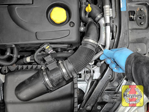 Illustration of step: Undo the circular clip on the air intake - use a 7mm socket or a spanner - step 3
