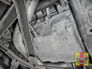 Illustration of step: Using a 15mm spanner or socket, carefully remove the sump plug and fully drain the oil - step 3