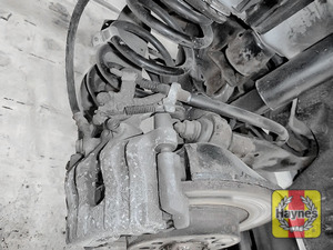 Illustration of step: Take a good look around the brake system and the suspension arm, check for any leaks - step 13