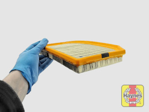 Illustration of step: Clean off any debris on the surface of the filter - step 12