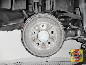 Illustration of step: Should the front brake pads need replacement, the rear drums should be checked for condition - step 9