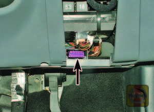 Illustration of step: The diagnostic connector is located on the driver's side of the fascia, behind the storage compartment - step 2