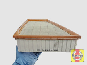 Illustration of step: Clean off any debris on the surface of the filter - step 5