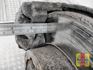 Illustration of step: Using a ruler, measure the approximate thickness of the remaining wear material on the brake pad - step 11