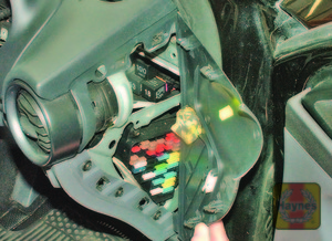 Illustration of step: Fuses are located behind a panel on the end of the drivers side fascia - step 1