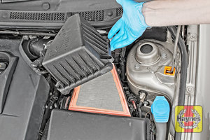 Illustration of step: Carefully lift away the top section of the air filter body - step 3