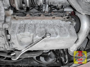 Illustration of step: With an oil catchment tray in position, use a 19mm spanner or socket to carefully remove the sump plug and fully drain the oil - step 4