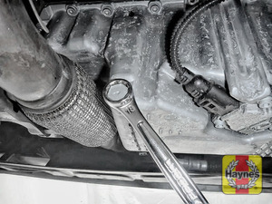 Illustration of step: Using a 18mm spanner or socket, carefully remove the sump plug and fully drain the oil - step 3