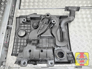 Illustration of step: Remove engine cover/air filter housing and turn upside down on a clean, flat surface - step 5