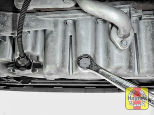 Illustration of step: Using a 19mm spanner or socket, carefully remove the sump plug and fully drain the oil - step 5