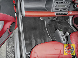 Illustration of step: Locate the battery - it's under the passenger seat carpet - step 1