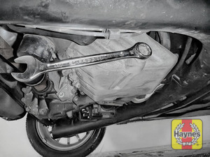 Illustration of step: Using a 24mm spanner or socket, carefully remove the sump plug and fully drain the oil - step 3