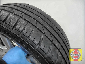 Illustration of step: Before refitting the tyres, take a look at the tyre tread, there is a UK legal requirement to have a minimum of 1 - step 11