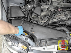 Illustration of step: The power steering fluid reservoir is located underneath this air intake - step 1