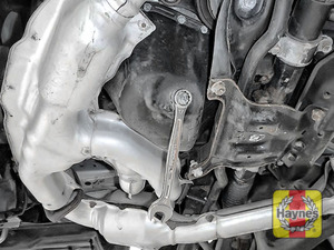 Illustration of step: Using a 17mm spanner or socket, carefully remove the sump plug and fully drain the oil - step 5
