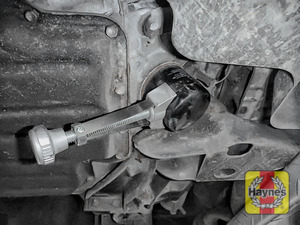 Illustration of step: Using a oil filter wrench, unscrew the filter anticlockwise and remove the old oil filter - step 4
