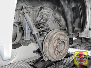 Illustration of step: Take a good look around the brake system and the suspension arm, checking for any leaks - step 9