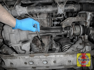 Illustration of step: Using a 17mm spanner or socket, carefully remove the sump plug and fully drain the oil - step 4