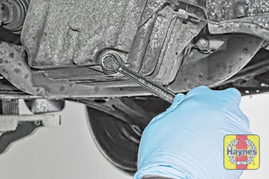 Illustration of step: Using a 13mm spanner or socket, carefully remove the sump plug and fully drain the oil - step 5
