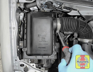 Illustration of step: Undo the circular clip on the air intake - use a screwdriver to do this - step 3