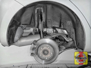 Illustration of step: As with the fronts, check for wear in the rear wheel hub bearings by grasping the wheel and trying to rock it - step 8