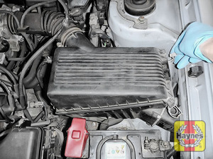 Illustration of step: Undo the four retaining clips on the air filter housing - step 2
