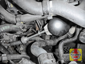 Illustration of step: Using an oil filter wrench, unscrew the filter anticlockwise and remove the old oil filter - step 5