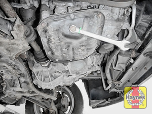 Illustration of step: Using a 14mm spanner or socket, carefully remove the sump plug and fully drain the oil - step 7