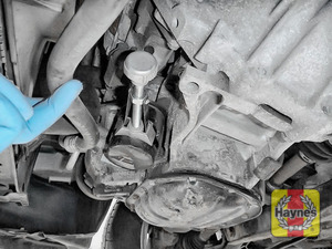 Illustration of step: Using an oil filter wrench, unscrew the filter anticlockwise and remove the old oil filter - step 3