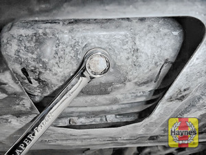 Illustration of step: Using a 14mm spanner or socket, carefully remove the sump plug and fully drain the oil - step 4