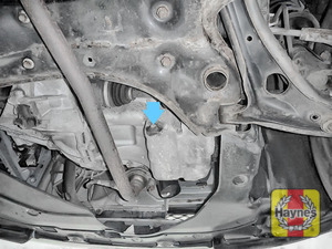Illustration of step: The sump plug is located on the base of the engine - it is accessed underneath the car - step 1