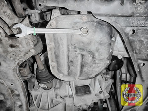 Illustration of step: Using a 14mm spanner or socket, carefully remove the sump plug and fully drain the oil - step 3