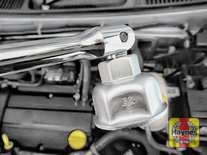 Illustration of step: Using a 32mm filter wrench socket, fit the tool securely onto the oil filter housing - step 3