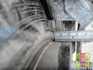 Illustration of step: Using a ruler, measure the approximate thickness of the remaining wear material on the brake pad - step 4