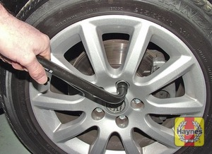 Illustration of step:  Slacken each wheel bolt by half a turn - step 5