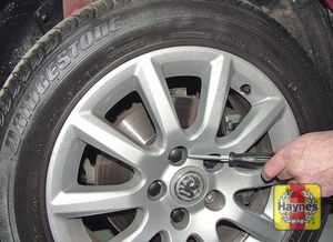Illustration of step:  On models with steel wheels, use the special tool to pull the wheel trim from the wheel - step 4