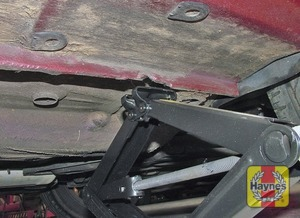 Illustration of step:  Locate the jack head below the jacking point nearest the wheel to be changed; the jacking point is indicated by an arrow in the sill - step 6